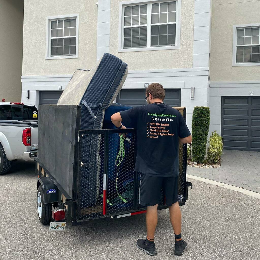 Owner, Ivan Gordiyenko loading a trailer with junk.